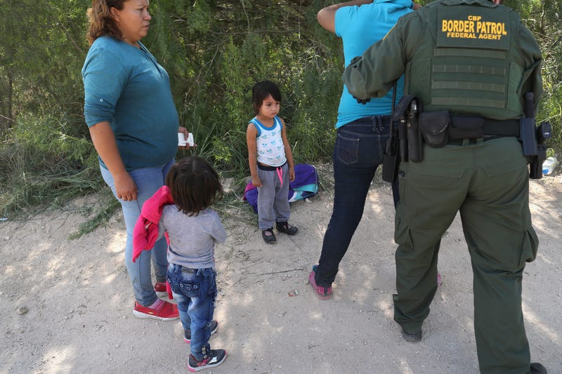 U.S. Border Patrol agents take Central American asylum seekers into custody on June 12, 2018, near McAllen, Texas. The immigrant families were then sent to a U.S. Customs and Border Protection processing center for possible separation under the Trump administration's zero tolerance policy toward undocumented immigrants.