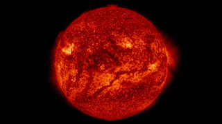Illustration for article titled NASA Spots A Huge Gash Across The Surface Of The Sun