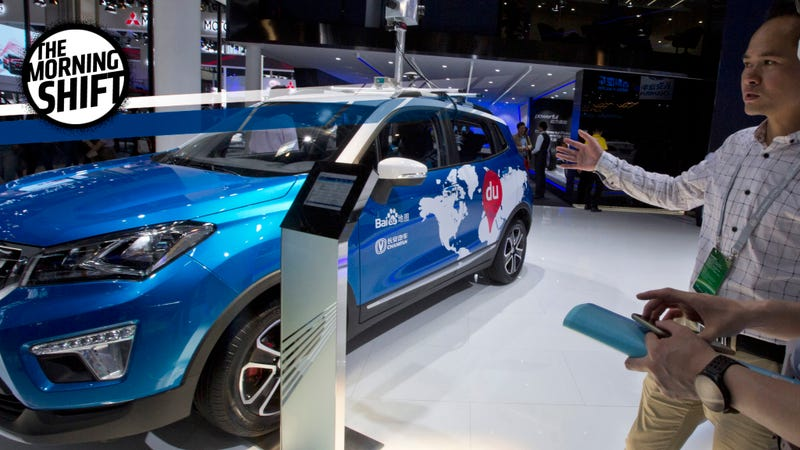 A promoter from Baidu talk about the vehicle used to capture images for their mapping services displayed at Auto China 2016 in Beijing, China, Monday, April 25, 2016. Image credit: Ng Han Guan/AP Images