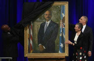 Attorney General Eric Holder (right) and his wife, Dr. Sharon Malone, help artist Simmie Knox (left) unveil Holder's official portrait during a ceremony at the Justice Department Feb. 27, 2015, in Washington, D.C.Mark Wilson/Getty Images