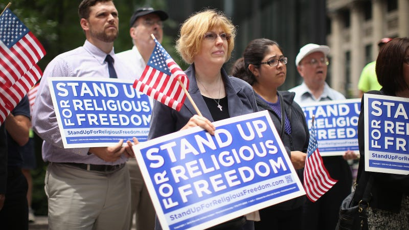 Religious freedom supporters hold a rally to praise the Supreme Court's decision in the Hobby Lobby, contraception coverage requirement case on June 30, 2014 in Chicago, Illinois.