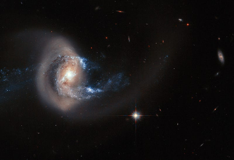 """Illustration for article titled A Near-Collision Stretched This Galaxy Like A """"Taffy Pull"""""""