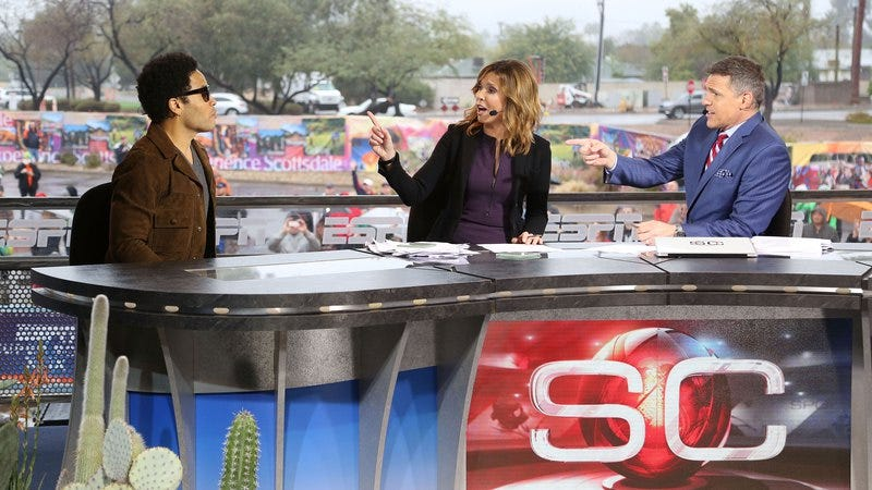 Lenny Kravitz, Hannah Storm, and Jay Crawford in 2015
