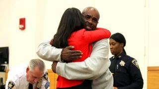 Derrick Deacon hugs his attorney after hearing he has been acquitted for a 1989 murder that he did not commit. News 12 Screenshot