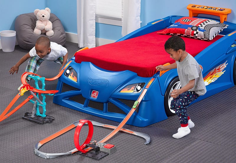 Illustration for article titled This Race Car Bed Is a Giant Extension Of Your Kid's Hot Wheels Tracks