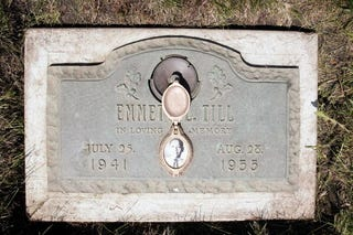 A plaque marks the grave site of Emmett Till at Burr Oak Cemetery in Aslip, Ill., on May 4, 2005. (Scott Olson/Getty Images)
