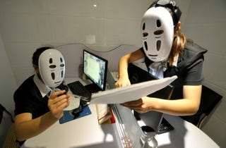Illustration for article titled Chinese Employees Relieve Stress with Studio Ghibli Masks
