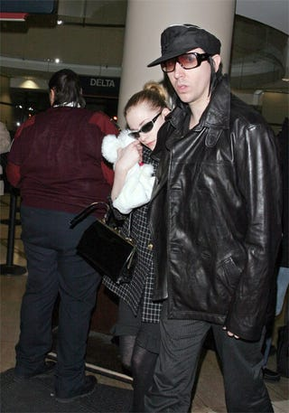 Illustration for article titled Marilyn Manson, Evan Rachel Wood Play With Plushie