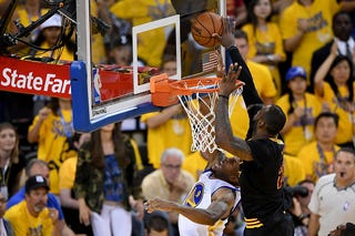 LeBron James of the Cleveland Cavaliers blocks a shot by Andre Iguodala of the Golden State Warriors in Game 7 of the NBA Finals at Oracle Arena on June 19, 2016, in Oakland, Calif.Thearon W. Henderson/Getty Images