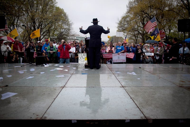 Former Presidential candidate Herman Cain speaks at a Tea Party Patriots' 'Road To Repeal Rally' on a rainy day March 24, 2012 in Washington, DC.