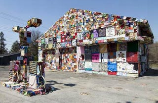 Illustration for article titled Artists Cover Abandoned Gas Station With Fabric Panels
