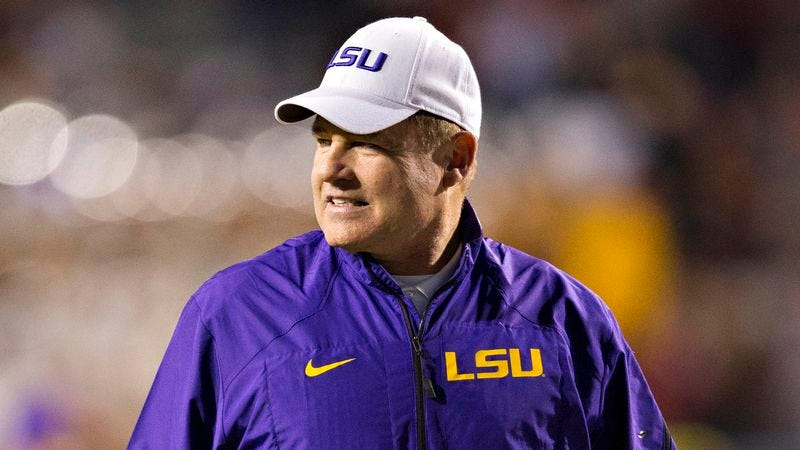 Illustration for article titled Les Miles Assures Recruits' Parents His Players Are Like Sons He Can Cut At Any Time