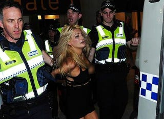 Illustration for article titled Model Strips Naked, Fights Cops At Aussie Rules Grand Final [NSFW]