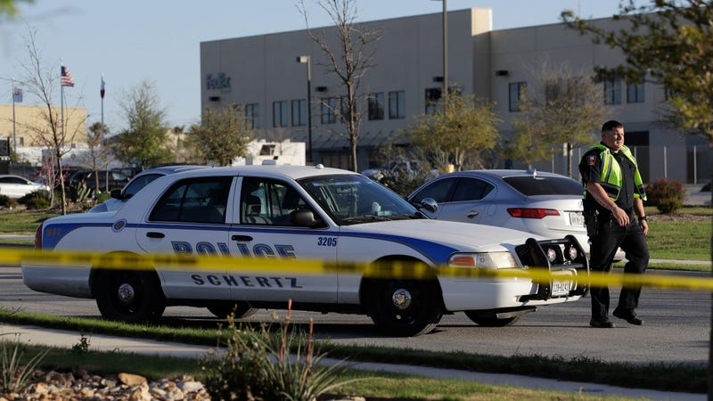 Police near the detonation of a package bomb at a Schertz, Texas, FedEx facility.