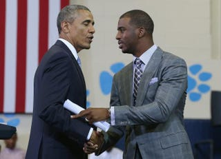 Los Angeles Clippers basketball player Chris Paul (right) introduces President Barack Obama at the Walker-Jones Education Campus in Washington, D.C., July 21, 2014.Mark Wilson/Getty Images