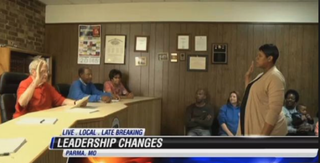"""Tyrus Byrd is sworn in as the mayor of Parma, Mo., April 14, 2015. After she won the election, several police officers and city officials quit, citing """"safety concerns.""""KSFV screenshot"""