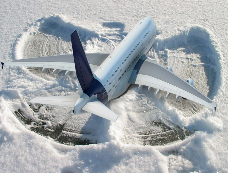 Illustration for article titled Grounded Plane Makes Snow Angel On Tarmac