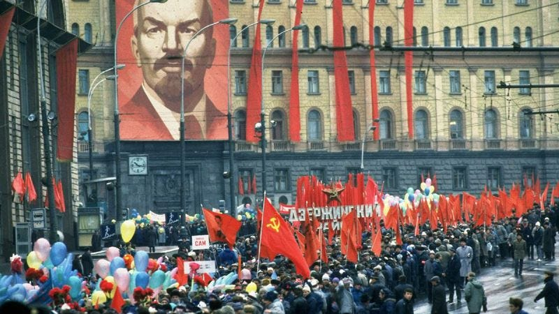 Thousands of Soviets gather in the Red Square to celebrate the USSR's victory.