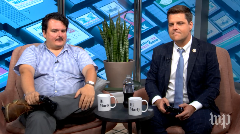 Washington Post reporter David Weigel (left) interviews Florida Congressman Matt Gaetz (right) while the two play Madden 18.