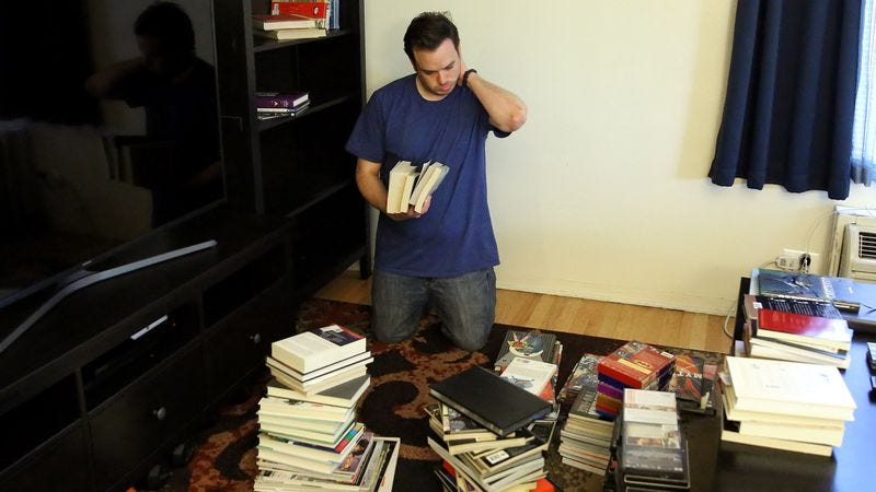 Illustration for article titled Man 20 Minutes Into Organizing Shelves Becomes Grimly Aware Of What Chaos He Has Wrought