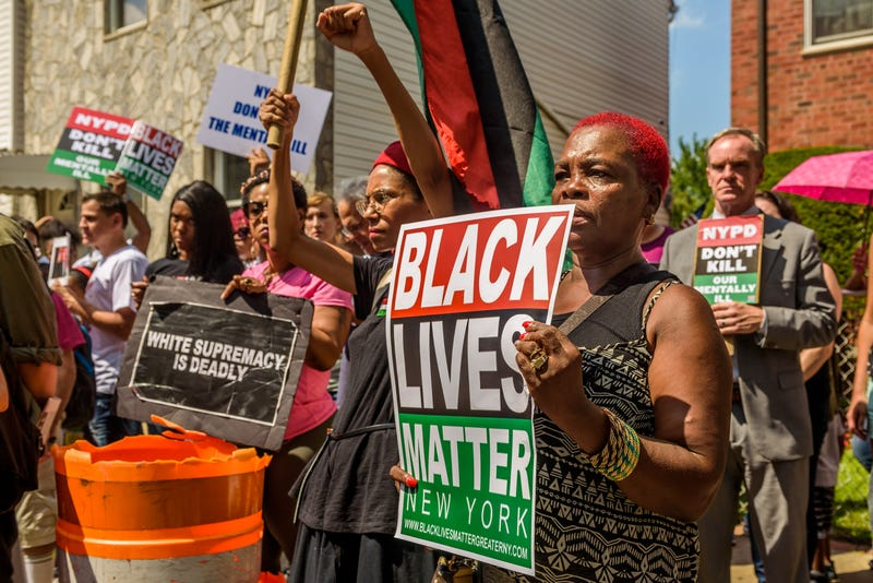 Over a hundred people gathered in front of the home of Dwayne Jeune, who was killed by New York City police, in Brooklyn, N.Y., on Aug. 19, 2017, to protest the killing of the mentally ill by the New York City Police Department. (Erik McGregor/Pacific Press/LightRocket via Getty Images)