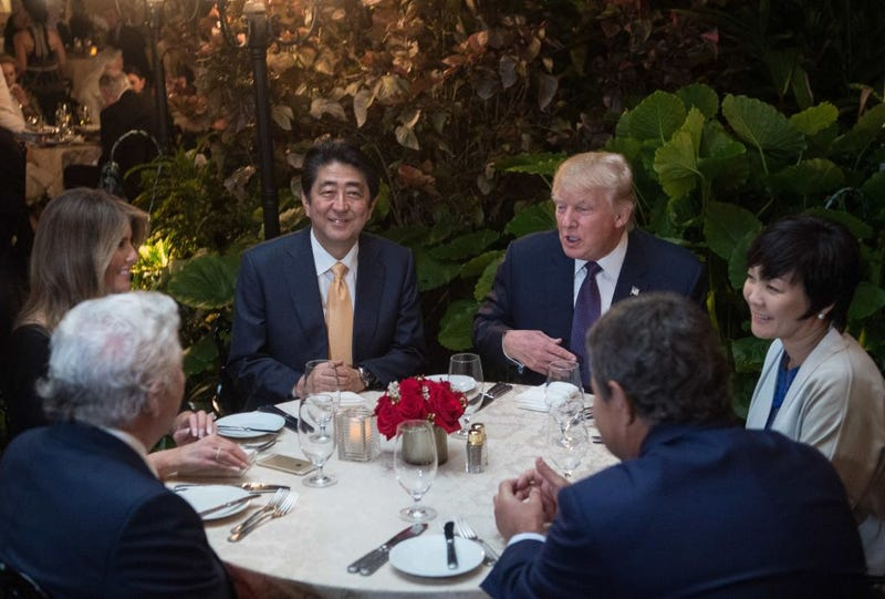 President Donald Trump (second from right) and Japanese Prime Minister Shinzō Abe (second from left) with others, including Abe's wife, Akie Abe (right), and first lady Melania Trump (left) dine at Trump's Mar-a-Lago resort Feb. 10, 2017. (Nicholas Kamm/AFP/Getty Images)