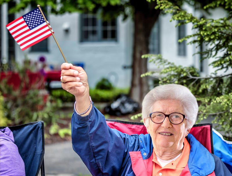 Illustration for article titled Old Lady At Parade Flapping Little American Flag Like A Motherfucker