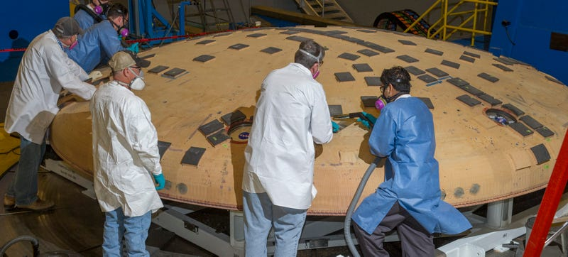 Illustration for article titled This Is How You Inspect an Exotic Spacecraft Heat Shield