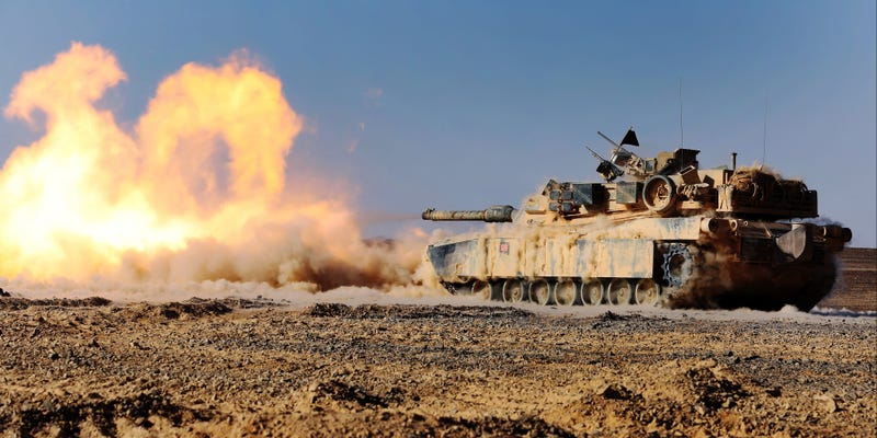 Illustration for article titled Kick ass photo of a M1 Abrams tank blasting its cannon like a fire beast