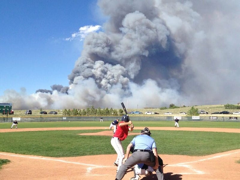 Illustration for article titled Colorado Forest Fire Produces Incredible Baseball Photo