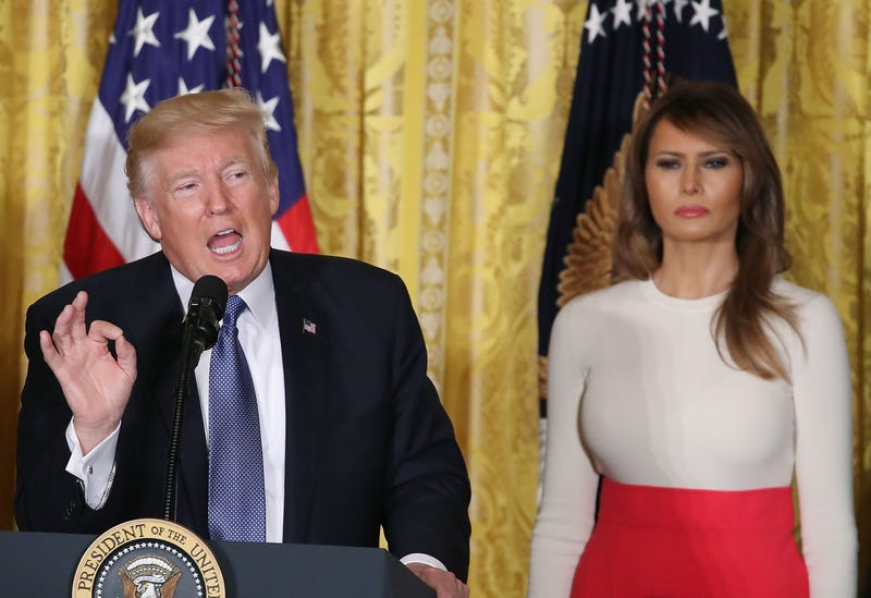 President Donald Trump is flanked by first lady Melania Trump as he speaks to guests gathered in the East Room of the White House in Washington, D.C., to celebrate Hispanic Heritage Month on Oct. 6, 2017. (Mark Wilson/Getty Images)