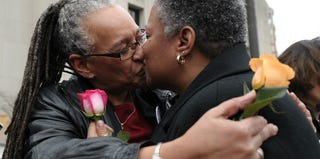 A same-sex couple after they applied for their marriage license at the D.C. Superior Court in 2010 (AFP/Getty)