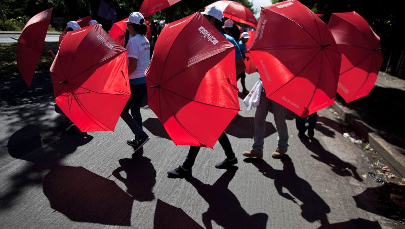 Demonstrators at International Day for the Elimination of Violence Against Women in Managua, Nicaragua/Image via AP.