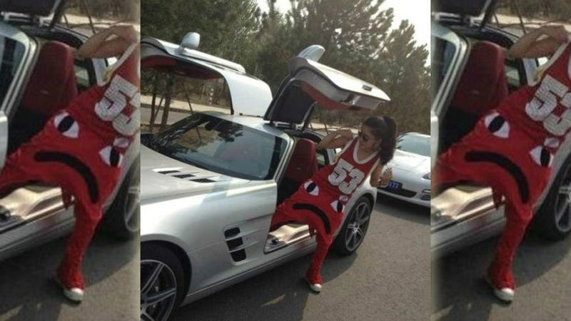 Illustration for article titled Here's A Chinese Woman With Frowny Pants Getting Out Of An SLS AMG