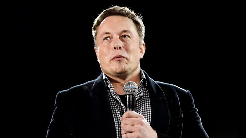 Elon Musk with his microphone.
