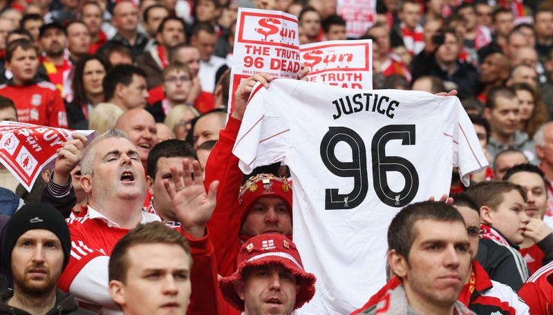 A Liverpool supporter holds up a 'Justice for the 96' jersey at a 2012 FA Cup match. (Photo credit: Scott Heavy/Getty)
