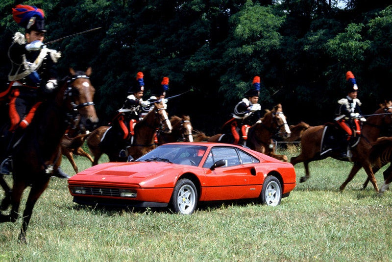 Today in bizarre Ferrari press shots  a 328 GTB sits idly by as what appear to be Napoleonic cavalr
