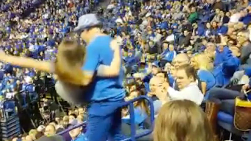 Illustration for article titled Dancing Kentucky Fan Picks Up Girl, Drops Her Down The Stairs