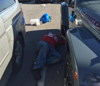 Illustration for article titled Sad Chiefs Fan Finds A Nice Spot To Lie Down In The Parking Lot