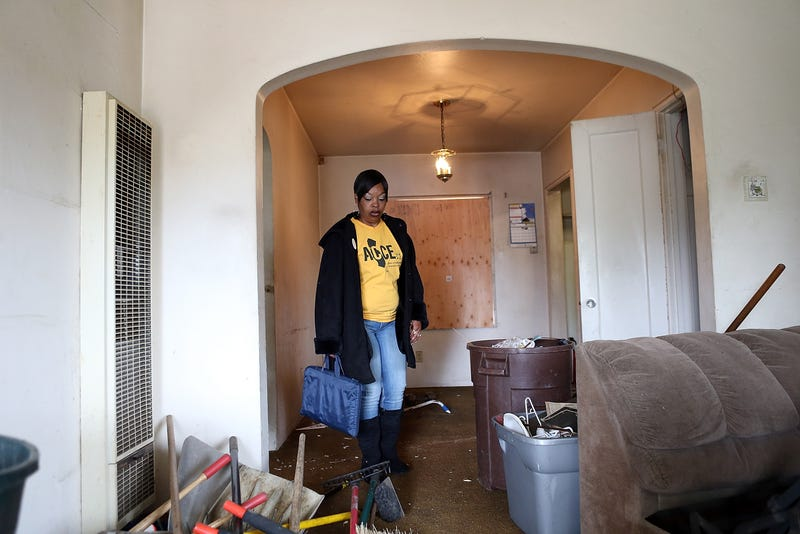 Marquita Ealy with the Richmond, California chapter of the Alliance of Californians for Community Empowerment (ACCE) tours a foreclosed home during a bus tour of foreclosed and blighted properties on July 13, 2012 in Richmond, California.