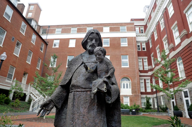 A Jesuit statue is seen in front of Freedom Hall, formerly named Mulledy Hall, on the Georgetown University campus on Sept. 1, 2016, in Washington, D.C.  (Jacquelyn Martin/AP Images)
