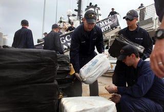 U.S. Coast Guard with five tons of seized cocaine. (Joe Raedle/Getty Images)