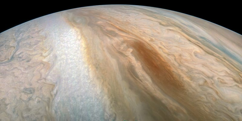 """A long, oval-shaped """"brown barge"""" on Jupiter—a transient cyclonic system."""