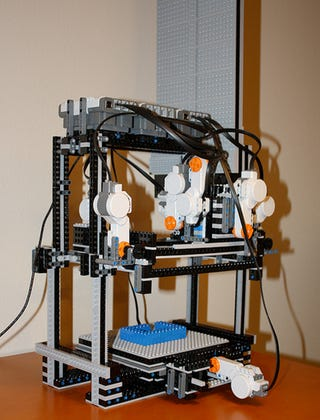 Illustration for article titled How Lazy Men Build Lego Creations—With a 3D Printer (Made From Lego)