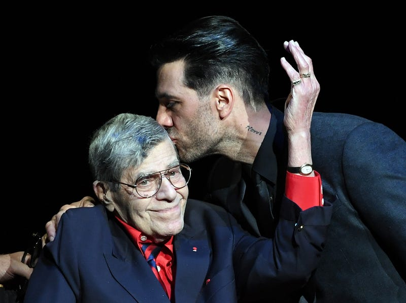Jerry Lewis, seen here being kissed by Criss Angel, who must not not a child from his first marriage. (Photo: Ethan Miller/Getty Images)