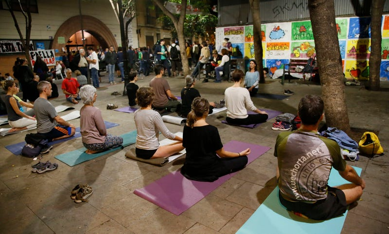 Photo: AP (These people are doing yoga in Barcelona, far from the scene of the South Carolina woman's bitter disappointment.)