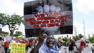A woman holds a sign as members of Lagos-based civil-society groups hold rally calling for the release of missing Chibok schoolgirls at the state government house in Lagos, Nigeria, May 5, 2014. PIUS UTOMI EKPEI/AFP/Getty Images