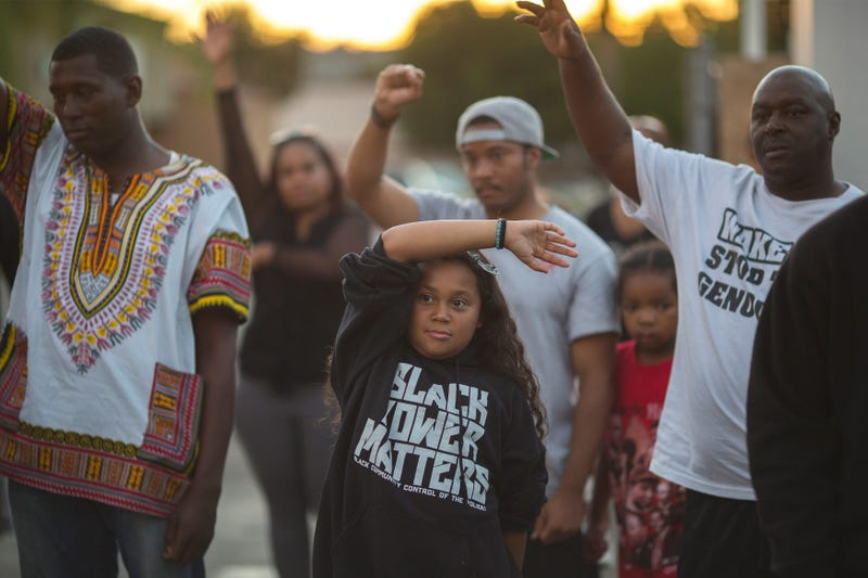 People gather to protest on Sept. 29, 2016, in El Cajon, Calif., at the site where an unarmed black man, Alfred Olango, 38, was shot by police.David McNew/Getty Images