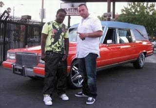 Illustration for article titled T-Pain Brings The Heat With Bright Orange Hearse