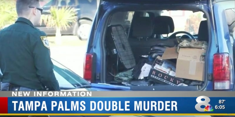 Police search a vehicle outside the home of Devon Arthurs and Brandon Russell in Tampa Palms, Florida (Screenshot from WFLA News Channel 8)